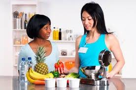 women looking at fruit
