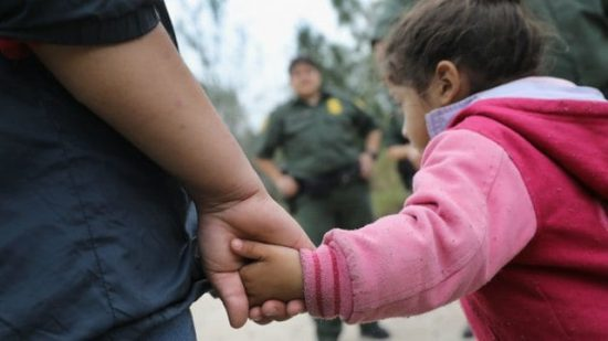 Image of a man holding a little girl's hand