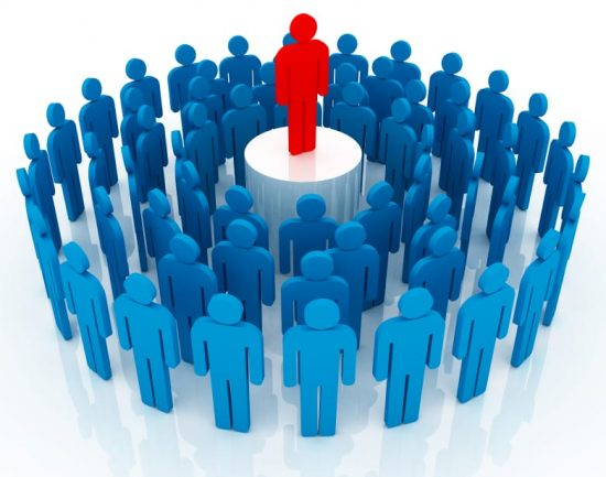 Group of blue stick people gathered around one red stick person who is standing on a pedestal