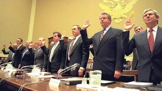 Men in suits taking an oath