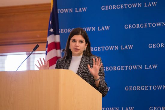 Woman speaking from a podium