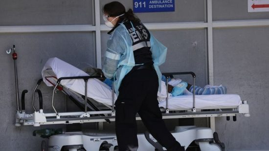 Health care worker pushing a stretcher
