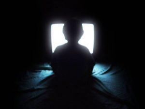 Boy infront of TV