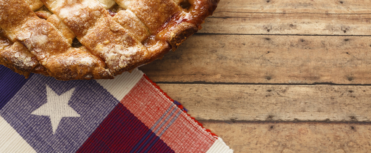 Latice crust apple pie on a red, white and blue theme