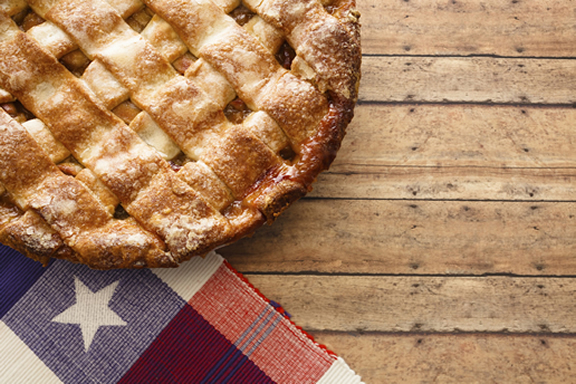 Pie and a red, white, and blue napkin on a table