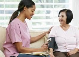 nurse taking a woman's blood pressure
