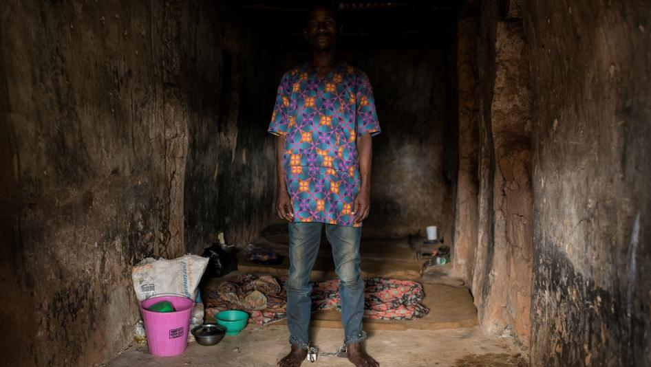 """Man with chained legs in a Christian """"rehabilitation"""" center in Ibadan City, Oyo State, Nigeria."""