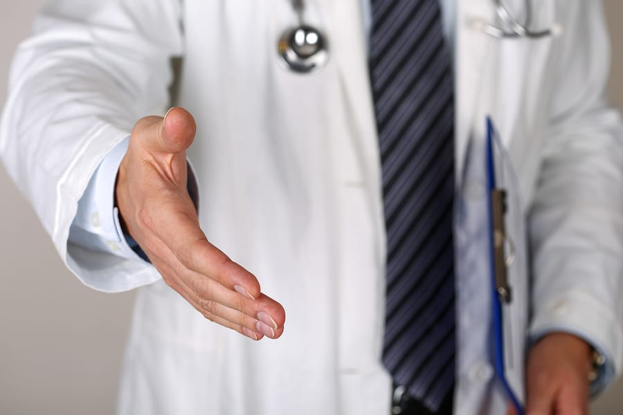 doctor reaching out to shake hands