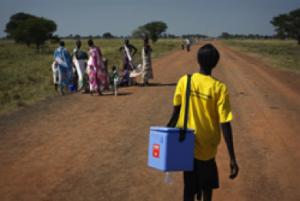 Woman with Immunization Kit