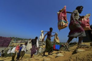 Rohingya refugees gathering bricks to make a road in at a refugee camp in Bangladesh