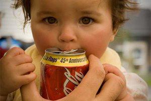 child drinking Coca Cola