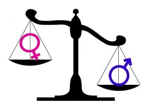 scales weighing female and male symbols